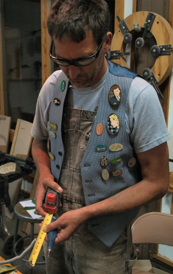 Manly badges and buttons on vest